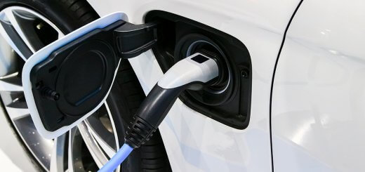 Power Supply Plugged For Electric Car Charging. Charging Station